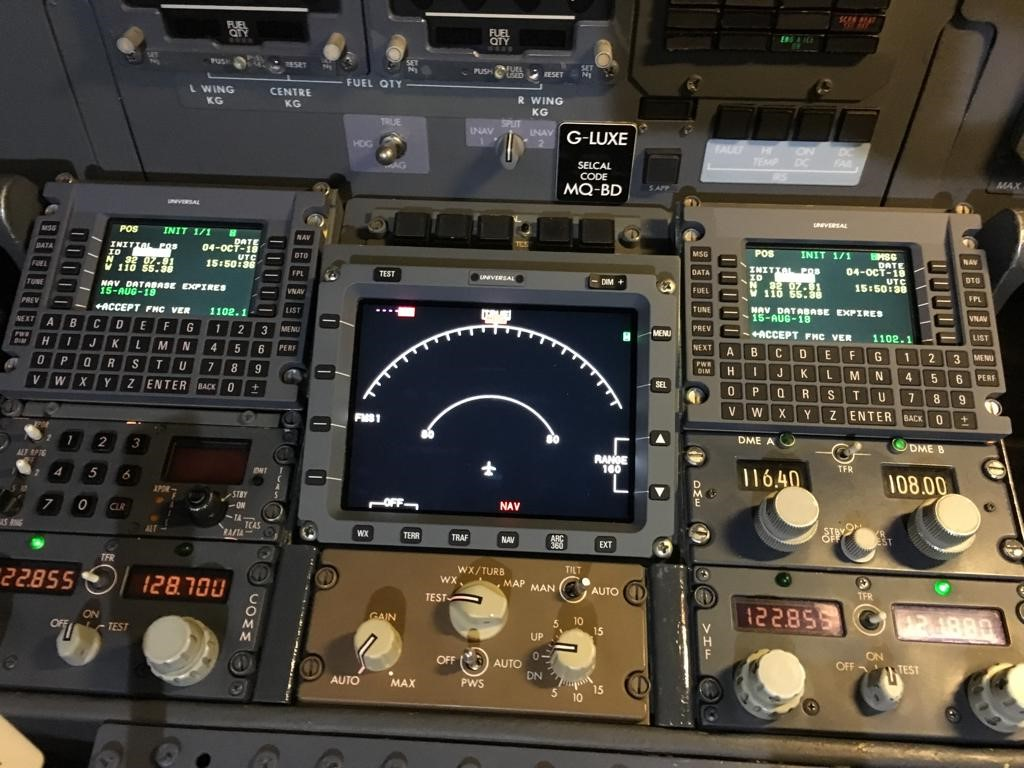 Dials, buttons and screens in an aircraft cockpit